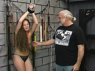 Curly hair cutie flogged in dungeon