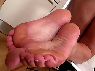 He sucks chocolate cake off her sexy toes and the lusty blonde gives a good footjob.