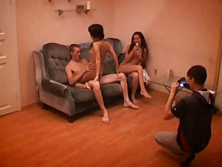 Two sexy teen girls and a guy make a threesome and we get a behind the scenes look.