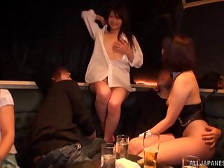 Japanese night club babes entertain the guests with blowjobs