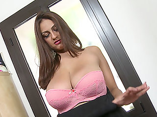 Elegant mature brunette Sandra Milka spits on a dildo before insertion