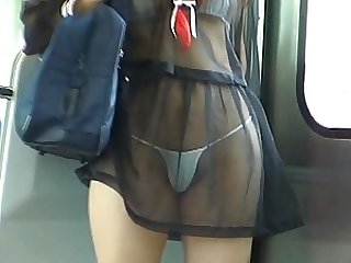 Mikan Hot Asian gal stands by the train doors in her sexy dress