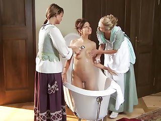Two horny maids seduce her madame and eat her pussy