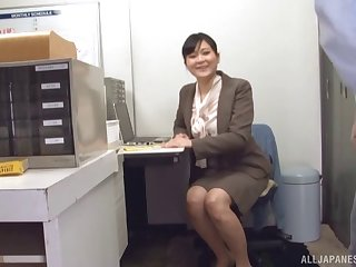 Secretary eagerly blows a coworker and takes a hot facial